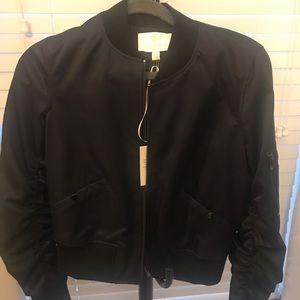 A cute navy jacket by Carlisle!